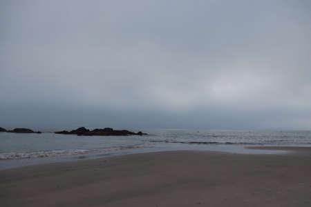 Samil beach at dusk with fog