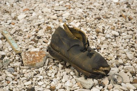 macadam: old worn boot on the crushed stone