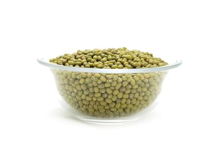 bowl of green mung beans isolated on white photo