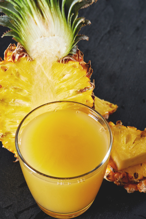 pineapple  glass: ripe pineapple and glass of pineapple juice close up