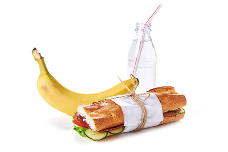 dinnertime: lunch with sandwich, banana and wayer isolated over white background Stock Photo