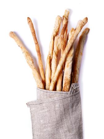 pretzel stick: grissini. sticks of dry, crisp bread in beige napkin Stock Photo