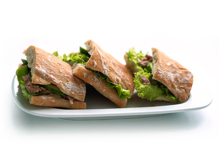 tunafish: tuna sandwiches with lettuce on a plate Stock Photo