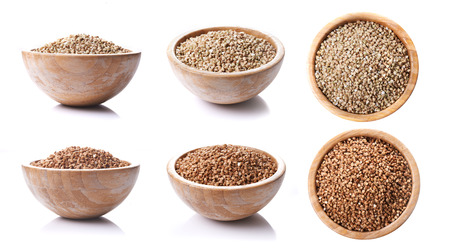 bowls with green and brown buckwheat isolated on white background 版權商用圖片