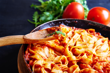 pasta with red tomatoe sauce in pan