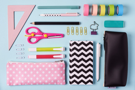 school supplies. pink and blue colors. flat lay composition