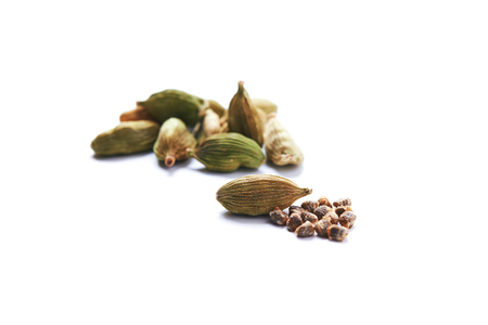 green dry seeds of cardamom isolated on white background