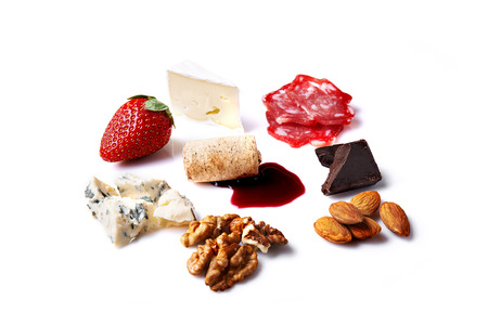 cheese, nuts, meat, chocolate, honey and strawberry and red wine spot isolated on white background Stock Photo