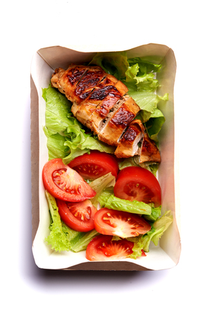 fried chicken fillet and salad in delivery box 스톡 콘텐츠