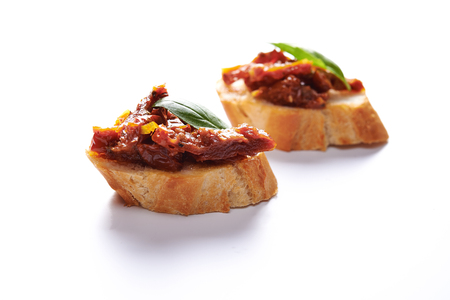 bruschetta with sun dried tomatoes isolated on white background