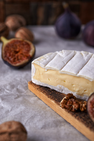 camamber cheese and fresh figs on wooden background Reklamní fotografie