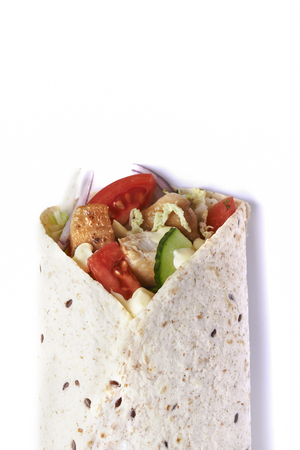 wrapped sandwich. tortilla with chicken and vegetables isolated on white background. top view Stok Fotoğraf