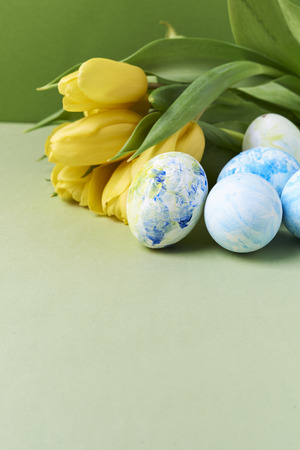 yellow tulips and painted eggs with copy space