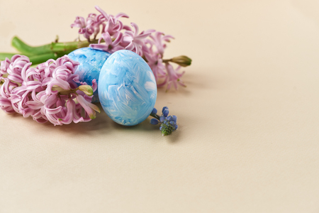 pink hyacinth and painted eggs on beige Stok Fotoğraf