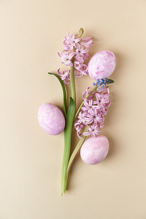 pink hyacinth and painted eggs. top view