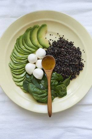 healthy dinner quinoa, cheese, spinach and avocado