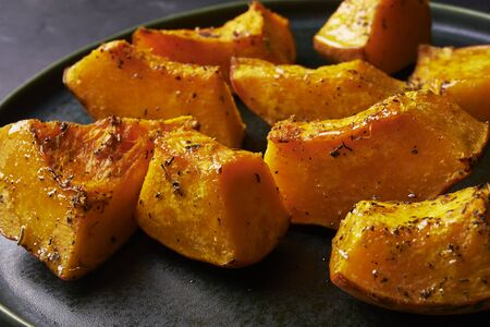 pieces of roasted pumpkin with herbs