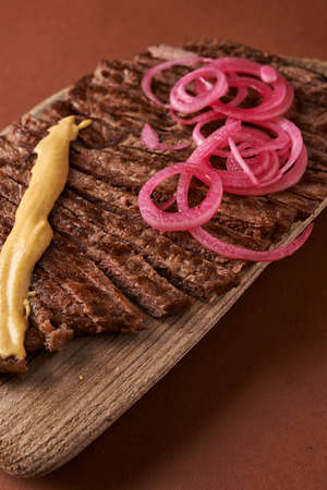 fried rump steak close up with onion and mustard,  Banco de Imagens