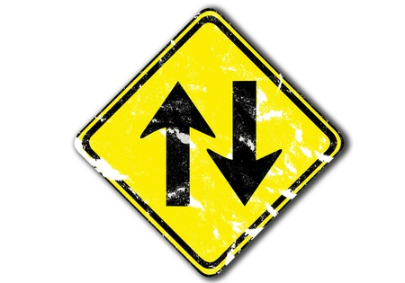grunge yellow traffic arrow sign two way traffic, paper craft isolated on white photo