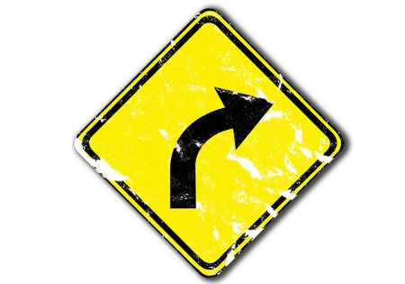 grunge yellow traffic sign, right curved warning from paper craft. photo