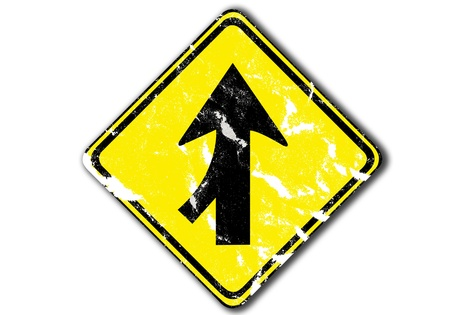 grunge yellow arrow traffic sign lanes merging left from paper craft isolated on white photo