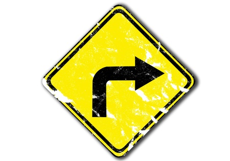 grunge yellow turn right arrow traffic sign from paper craft. photo