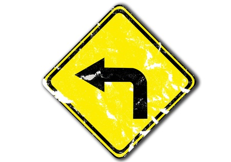 turn left: grunge yellow turn left arrow traffic sign from paper craft. Stock Photo
