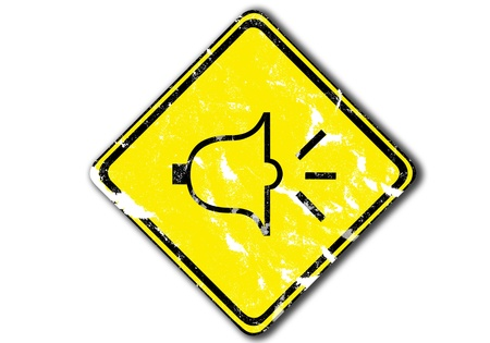honk: grunge yellow  traffic sign urging people to honk at dangerous turns from paper craft.