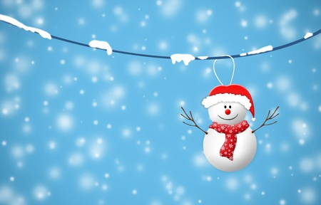 snowman hanging in snowy night on Christmas day Stock Photo - 11708941