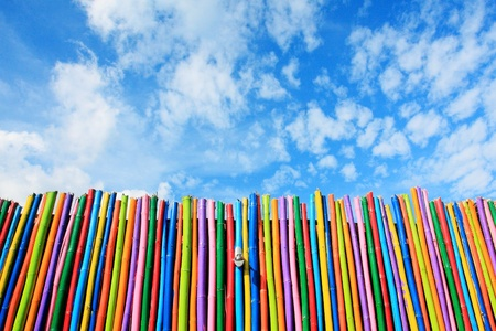 colorful wooden wall with nice blue sky.