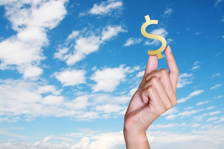 hand holding dollar with blue sky background, concept