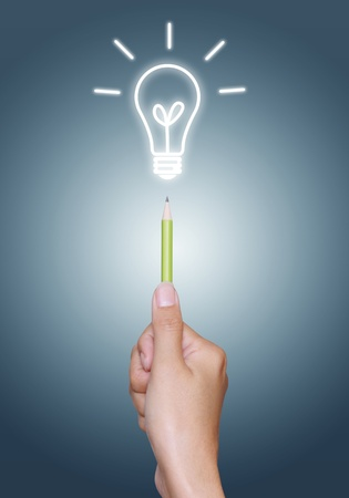 light bulb on pencil in hand, blue background