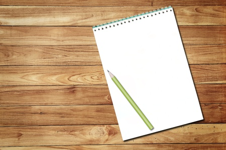 white notebook and pencil on wood background Stock Photo - 13175960