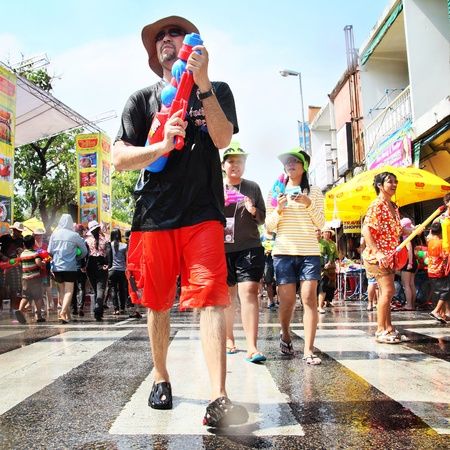 CHIANGMAI, THAILAND - APRIL 13: Songkran Festival is celebrated in Thailand as Thais traditional New Year from 13 to 15 April by throwing water at each other, on 13 April 2012 in Chiangmai, Thailand