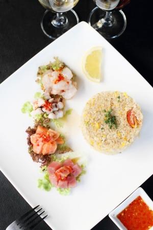 fried rice with salad sasimi, Thai style fusion food photo
