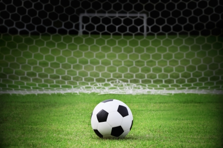 Soccer ball on the green field Stock Photo - 14960192