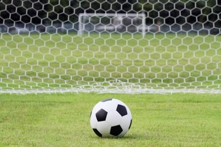 soccer net: Soccer ball on green field Stock Photo