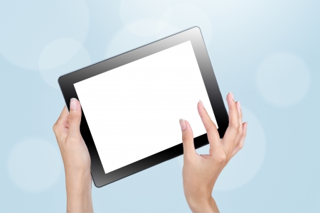 Hands holding tablet and touch screen with blank white screen on blue background Stock Photo - 15735708