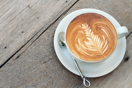 Hot milke coffee on wood table photo