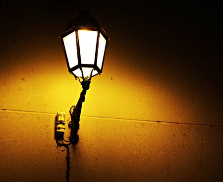 Old street lamps on the streets of the city as a reminder of years gone by. Stock Photo