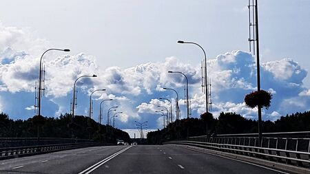 Panorama of thick cumulus clouds on the horizon on a summer sunny day.
