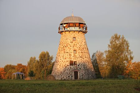 Stone round tower from an old windmill on a morning autumn day. Latvia, September 2019.