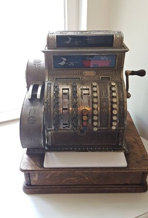 Very old antique cash register for the interior in the Malpils Manor room. Latvia, May 2019.