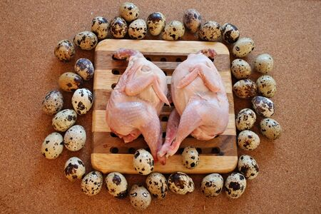 Two quail carcasses on the board and many small eggs.