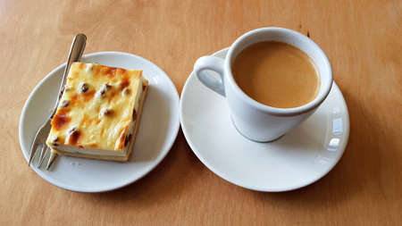 Traditional black coffee and curd cheese cake with raisins for morning breakfast