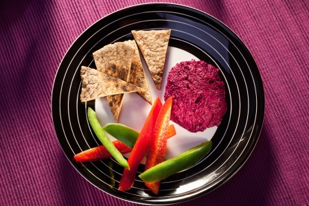 humus: beetroot humus with whole wheat pita bread and vegetables