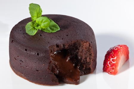 molten: Chocolate fondant with strawberry Stock Photo