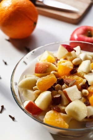 nit: Fruit salad with spice and water