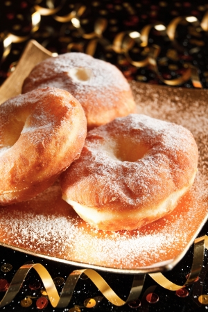 Powdered sugar crusty carnival donuts
