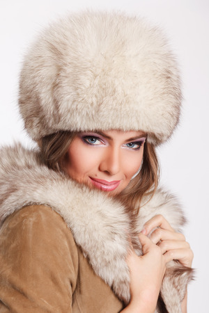 femme fatale: Close-up of a beautiful rich woman wearing fur Stock Photo
